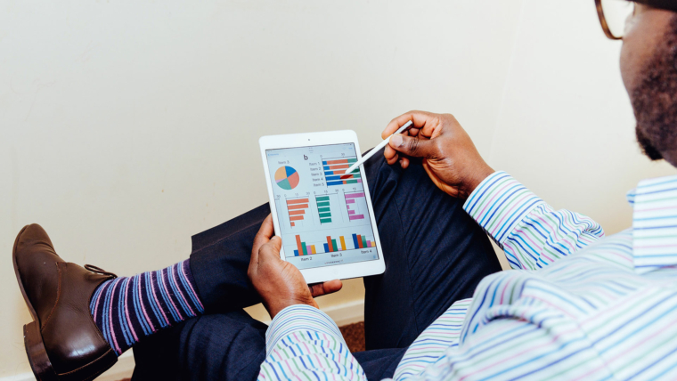man-looking-at-charts-on-a-tablet-innovent-labs-africa