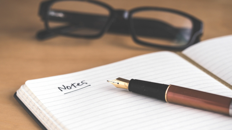 taking-notes-with-a-pen-notebook-innovent-labs-africa