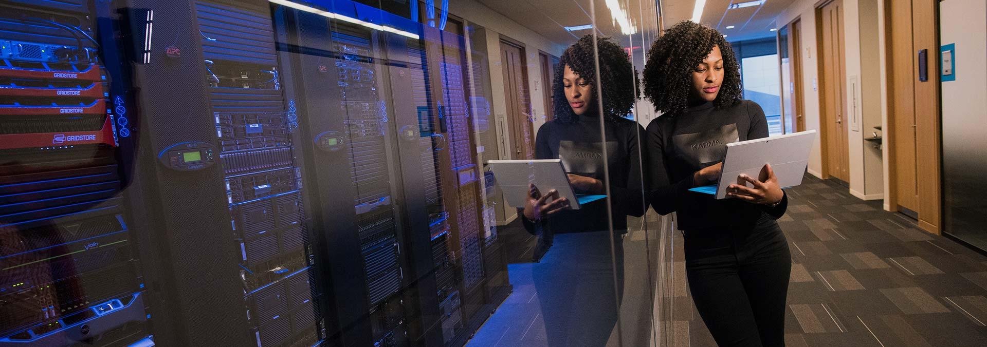 woman-standing-using-a-laptop-near-a-server-technology-africa