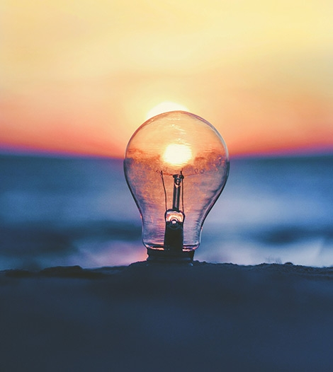 a-light-bulb-infront-of-sunset-on-a-beach-innovent-labs-africa